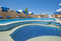 Swimming pool at at luxury tropical holiday villa Royalty Free Stock Images