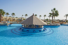Swimming pool in a luxury tropical hotel resort Stock Photos