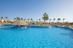 Swimming pool in a luxury tropical hotel resort Stock Photo