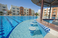Swimming pool in a luxury tropical hotel resort Royalty Free Stock Images