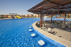 Swimming pool in a luxury tropical hotel resort Royalty Free Stock Image