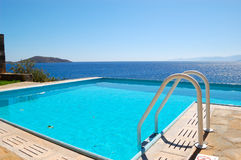 Swimming pool at luxury villa. Crete, Greece royalty free stock photography