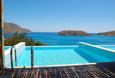 Swimming pool by luxury villa. With a view on Spinalonga Island, Crete, Greece stock photo