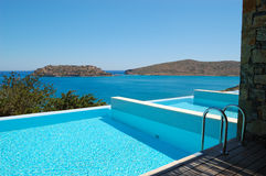 Swimming pool by luxury villa Royalty Free Stock Image