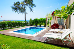 The swimming pool at luxury villa. Antalya, Turkey royalty free stock photography