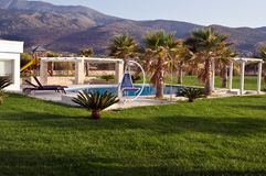 Swimming pool at the luxury villa, Crete, Greece . Royalty Free Stock Photography
