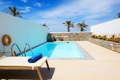 Swimming pool at luxury villa. Crete, Greece stock photography