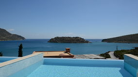 Swimming pool at luxury villa with view on Spinalonga island Stock Photography