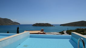 Swimming pool at luxury villa with view on Spinalonga island. Crete, Greece stock footage