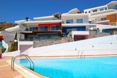 Swimming pool by luxury villas Stock Photos