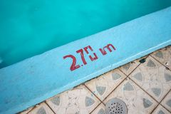 Swimming pool with 2.70m depth marker painted in red stock photo