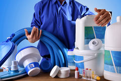Swimming pool maintenance worker with blue background Stock Images