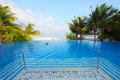 Swimming pool in Maldives beach Stock Photography