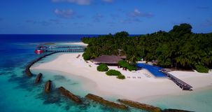 Swimming pool in maldives hotel resort with white sand beach tropical islands with drone aerial flying birds eye stock footage