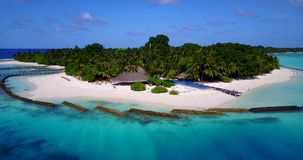 Swimming pool in maldives hotel resort with white sand beach tropical islands with drone aerial flying birds eye. View with aqua blue sea water and sunny sky stock video