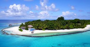 Swimming pool in maldives hotel resort with white sand beach tropical islands with drone aerial flying birds eye Stock Photo