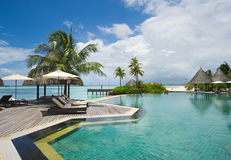 Swimming pool in maldives island resort Stock Images