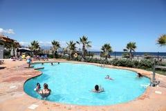 Swimming pool in mediterranean resort Stock Images