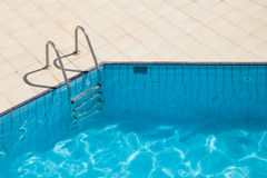Swimming pool with metal ladder Royalty Free Stock Photo