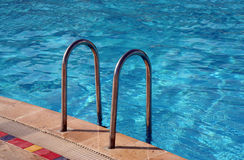 Swimming pool with Metal Ladder Stock Images