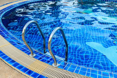 Swimming Pool with Metal Stair Stock Photography