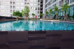 Swimming Pool with Modern Condominium Background. Great for Any Use royalty free stock photography