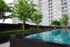 Swimming Pool with Modern Condominium Background. Great for Any Use royalty free stock photo