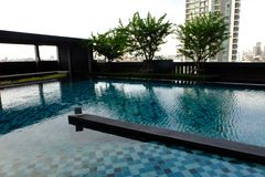Swimming Pool with Modern Condominium Background. Great for Any Use stock image