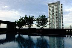 Swimming Pool with Modern Condominium Background. Great for Any Use royalty free stock images