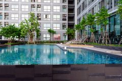 Swimming Pool with Modern Condominium Background. Great for Any Use royalty free stock photos