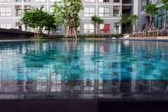 Swimming Pool with Modern Condominium Background. Great for Any Use royalty free stock image
