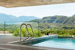 Swimming pool of a modern house Stock Images