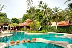 Swimming pool at modern luxury hotel Stock Photos