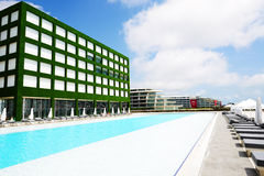 The swimming pool at modern luxury hotel Royalty Free Stock Image