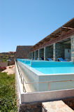 Swimming pool at the modern luxury villa. Crete, Greece royalty free stock photos