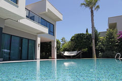 Swimming pool at the modern villa royalty free stock photos