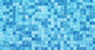 Swimming pool mosaic bottom caustics ripple like sea water and flow with waves background, sport and relax. Concept stock video footage