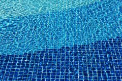 Swimming pool mosaic bottom caustics ripple like sea water. Texture of water surface. Top view. water waves with. Swimming pool mosaic bottom caustics ripple royalty free stock photos