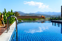 Swimming pool with mountain Royalty Free Stock Images