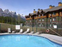Swimming pool in the mountains. Hotel with swimming pool in the mountains stock photography