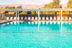 Swimming pool with moutain and blue sky Stock Images