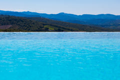 Swimming pool with natural landscape view Royalty Free Stock Image