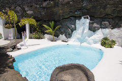 Swimming pool in natural volcanic rock area royalty free stock photography