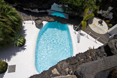 Swimming pool in natural volcanic rock area royalty free stock photos