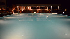 Swimming pool near bar in night illumination at the luxury hotel. Crete, Greece stock video footage