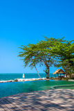 Swimming pool near the beach at high class resort Stock Images