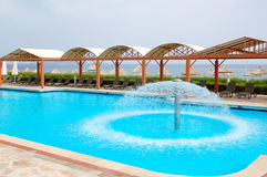 Swimming pool near beach at luxury hotel Royalty Free Stock Photo