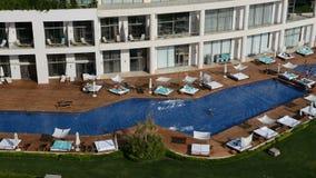 The swimming pool near beach at the luxury hotel. Antalya, Turkey stock footage