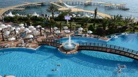 The swimming pool near beach at the luxury hotel. Antalya, Turkey stock video footage