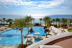 Swimming pool near beach at luxury hotel Stock Photo